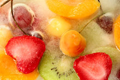 Mix of berries and fruit in ice Stock Image