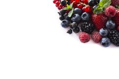 Mix berries and fruits at border of image with copy space for text. Black-blue and red food. Ripe blackberries, blueberries, straw Royalty Free Stock Image