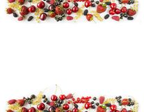 Mix berries and fruits at border of image with copy space for text. Ripe cherries, strawberries, currants and mulberrieson white b. Ackground. Background berries royalty free stock photography