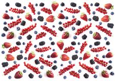 Mix berries and fruits on white background. Ripe blueberries, blackberries, strawberries and red currants. Top view. Black-blue an. D red food. Background stock images