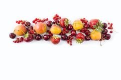 Mix berries isolated on a white. Ripe apricots, red currants, cherries and strawberries. Berries and fruits with copy space for te. Xt. Various fresh summer Royalty Free Stock Image