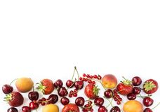 Mix berries isolated on a white. Ripe apricots, red currants, cherries and strawberries. Berries and fruits with copy space for te royalty free stock photo