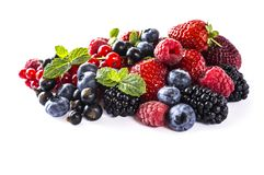Mix berries isolated on a white. Ripe blueberries, blackberries, raspberries, currants and strawberries with mint. Berries and fru. Its with copy space for text Stock Photography