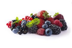 Mix berries isolated on a white. Ripe blueberries, blackberries, red currants, black currant, raspberries and strawberries. Various fresh summer berries on Stock Image