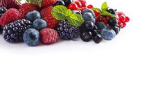 Mix berries isolated on a white. Ripe blueberries, blackberries, red currants, black currant, raspberries and strawberries. Various fresh summer berries on Stock Photography