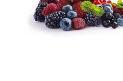 Mix berries isolated on a white. Ripe blueberries, blackberries, red currants, black currant, raspberries and strawberries. Various fresh summer berries on Stock Photo
