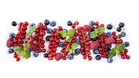 Mix berries isolated on a white. Ripe blueberries, red currants, black currant and raspberries. Berries and fruits with copy space. Mix berries isolated on a Stock Photo