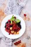 Mix berries. On plate and on a table Royalty Free Stock Photo