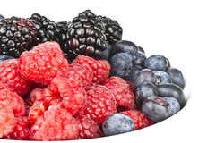 Mix Berries. Mixed berries on a white bowl Stock Photo