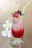 Mix berry soda with ice on wood background Stock Image