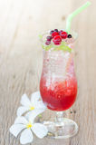 Mix berry soda with ice on wood background Royalty Free Stock Photos