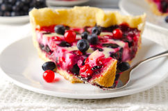 Mix berry tart, pie, cake with raspberries, bilberries, bluberries, red currant and cream on white background Stock Photo