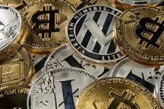 Cryptocurrency concept. Rich stack of bitcoins, litecoins and ethereum. Stock Images