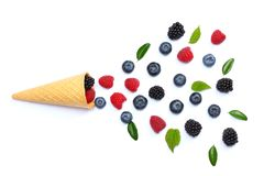 Mix of blueberries, blackberries, raspberries in ice cream cone isolated on white background. top view stock images
