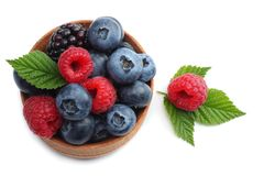 Mix of blueberries, blackberries, raspberries in wooden bowl isolated on white background. top view Stock Images