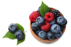 Mix of blueberries, blackberries, raspberries in wooden bowl isolated on white background. top view Royalty Free Stock Image