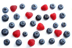 Mix of blueberries, raspberries isolated on white background. top view Stock Images