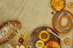 Mix of bread on the sackcloth background. Assortment of baked goods with space for text. Mix of bread on the sackcloth background. Rustic style. Top view Royalty Free Stock Photography