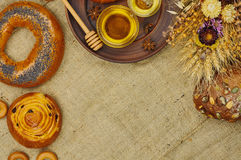 Mix of bread on the sackcloth background. Assortment of baked goods with space for text. Mix of bread on the sackcloth background. Rustic style. Top view Stock Photos