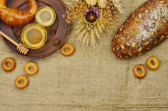 Mix of bread on the sackcloth background. Assortment of baked goods with space for text. Mix of bread on the sackcloth background. Rustic style. Top view Royalty Free Stock Photo