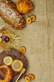 Mix of bread on the sackcloth background. Assortment of baked goods with space for text. Mix of bread on the sackcloth background. Rustic style. Top view Stock Photography