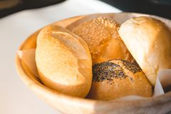 Mix breads in basket. Mixed bread in basket isolated on white background royalty free stock images