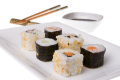 Mix of california rolls and makizushi. Sushi rolls, wooden chopsticks and soy sauce. Isolated on white Stock Photos