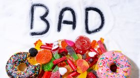 Mix of candy donut sugar word bad written royalty free stock image