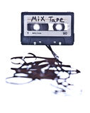 Mix cassette with tape spilled out. White background stock image