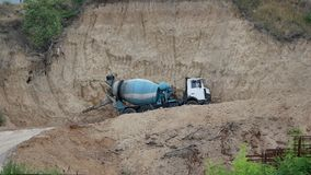 Mix cement truck works in the quarry