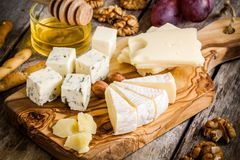 Mix Cheese: Emmental, Camembert, Parmesan, blue cheese, with walnuts and honey Royalty Free Stock Photos