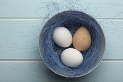 A mix of chicken and guinea fowl eggs in a bowl stock photography