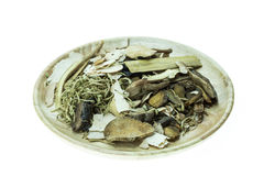 Mix of chinese herbal medicine in wooden dish isolated on white Royalty Free Stock Images