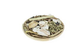 Mix of chinese herbal medicine in wooden dish isolated on white Royalty Free Stock Photo