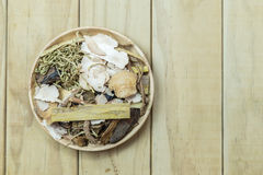 Mix of chinese herbal medicine in wooden Stock Images