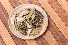 Mix of chinese herbal medicine in wooden Royalty Free Stock Image