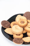 A mix of chocolate chip cookies on a black plate Royalty Free Stock Photography
