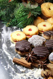 Mix of Christmas cookies with cinnamon and candle Stock Photo