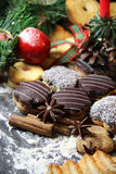Mix of Christmas cookies with cinnamon and candle Stock Image