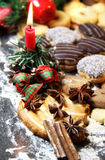 Mix of Christmas cookies with cinnamon and candle Royalty Free Stock Image