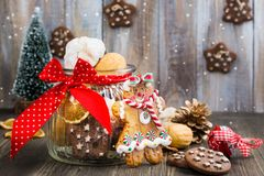 Mix of Christmas cookies on wooden table with Christmas decor. Mix of Christmas cookies - nuts, shortbreads, gingerbread cookies on wooden table with Christmas Stock Photography