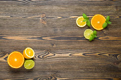 Mix citrus fresh fruit on the white wooden table Stock Image