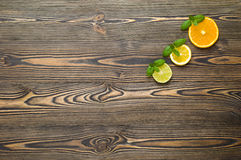 Mix citrus fresh fruit on the white wooden table Stock Photography