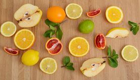 Mix citrus fresh fruit on the wooden table royalty free stock images