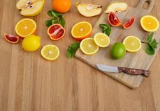 Mix citrus fresh fruit on the wooden table royalty free stock image