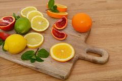 Mix citrus fresh fruit on the wooden table royalty free stock photos