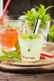 Mix of cocktails with rum and mint on the wooden table Stock Image