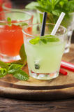 Mix of cocktails with rum and mint on the wooden table Royalty Free Stock Photo