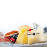 Mix cold cut on a stone with fresh pears Royalty Free Stock Photos