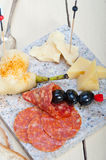Mix cold cut on a stone with fresh pears Stock Photos